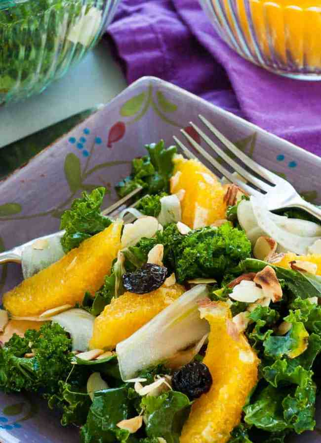 This flavorful salad is made with curly kale, raw fennel slices, sectioned orange slices, dried cherries, and slivered toasted almonds. All tossed with an orange juice, balsamic vinegar dressing. | joeshealthymeals.com