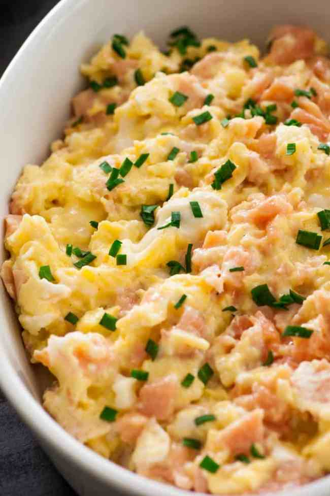Creamy scrambled eggs with smoked salmon. Tasty for breakfast, lunch, or dinner. | joeshealthymeals.com