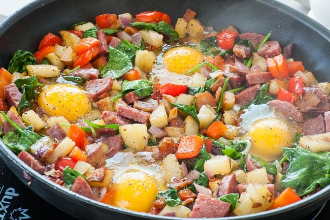 Breakfast hash with bacon and salami. Add a fried egg for a perfect meal. | joeshealthymeals.com
