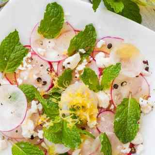 Shaved radish salad on a white plate.