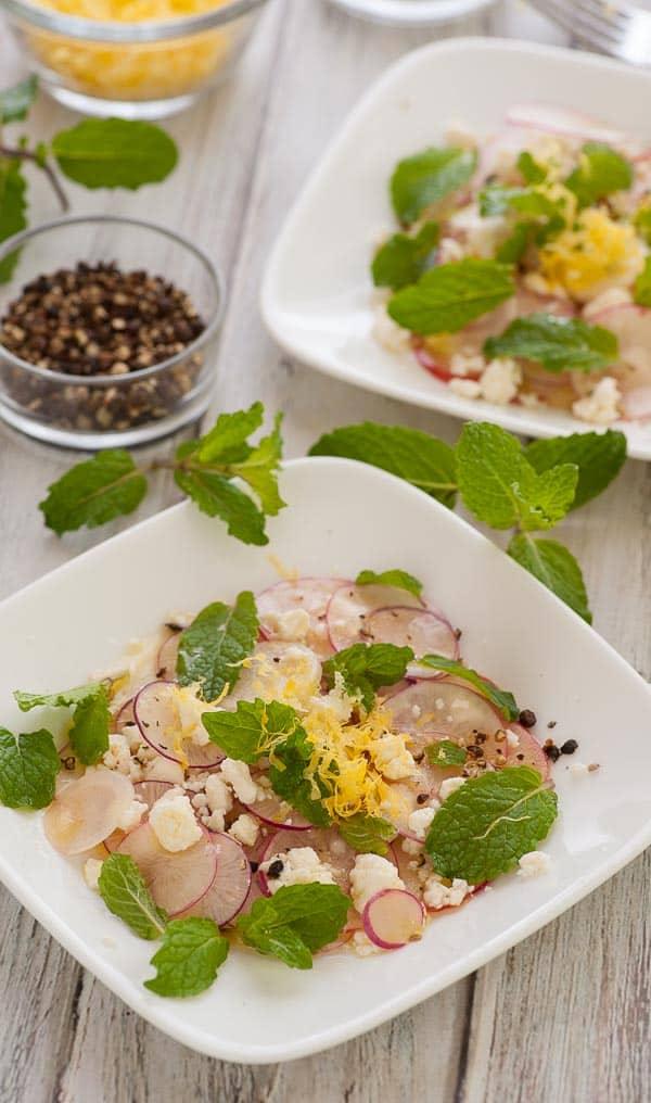 2 plates of shaved radish salad. | joeshealthymeals.com