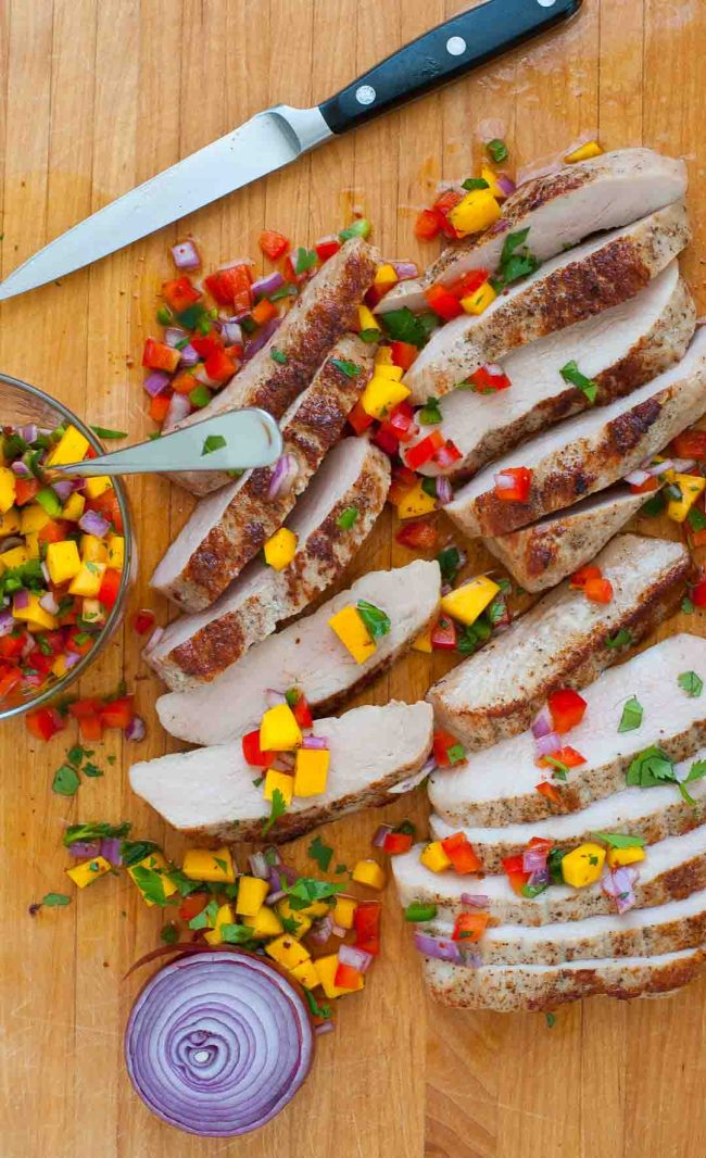 Healthy pork tenderloin steaks with spicy salsa. | joeshealthymeals.com