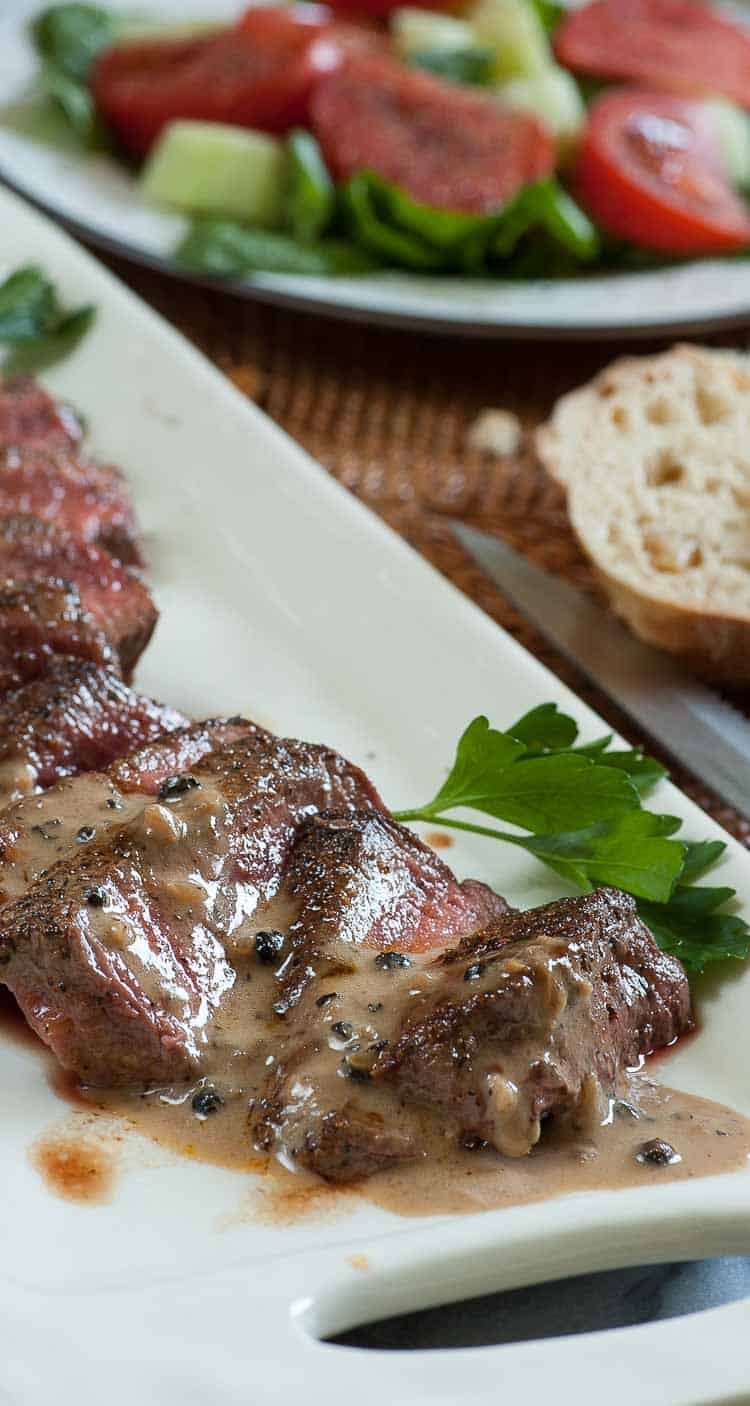 Filet mignon with peppercorn sauce is a luxury treat...perfect for a date night, stay home meal. | joeshealthymeals.com
