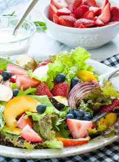 Fresh garden greens salad with fruit and yogurt dressing. | joeshealthymeals.com