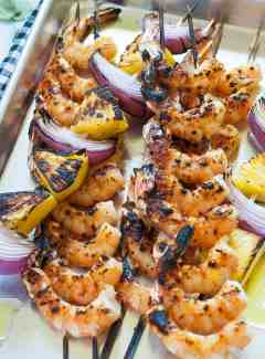 Grilled shrimp kabobs with orange glaze. | joeshealthymeals.com