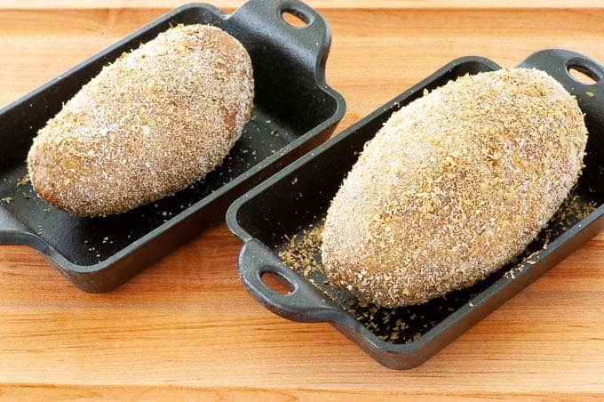 Seasoned potato skins ready for baking.