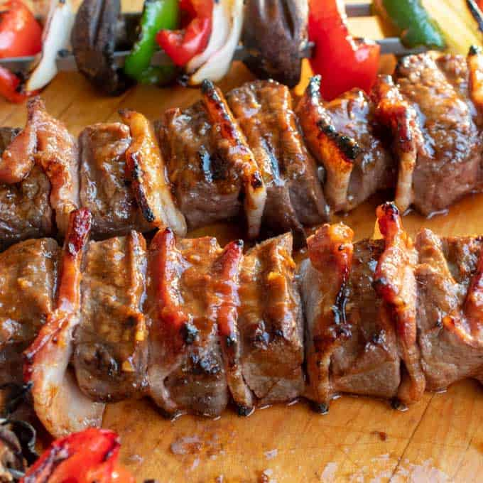Steak kabobs surrounded with bacon and brushed with a flavorful glaze.