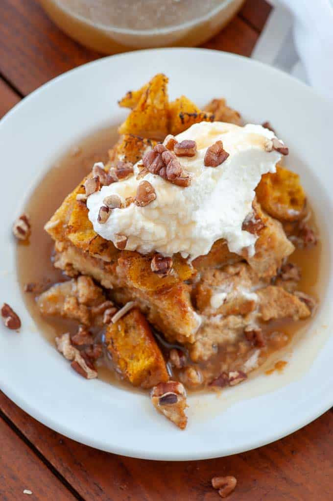 Pumpkin bread pudding on a plate.