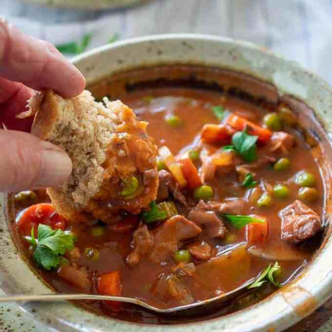 chicken stew with a chunk of bread