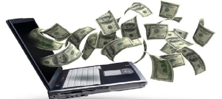 money bills flying from laptop