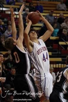 Otis-Bison Cougar Brandon Pechanec (#44) powers through the Ellsworth Bearcats' defense during the 2012 Hoisington Winter Jam Basketball Tournament.
