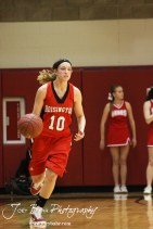 Jordin Greer (#10) of the Hoisington Lady Cardinals dribbles the ball down the court against the Russell Lady Broncos at the 2012 Hoisington Winter Jam Basketball Tournament.