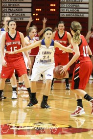Kaitlyn Walker (#24) of the Russell Lady Broncos stands between Hoisington Lady Cardinals Savannah Rose (#15) and Jordin Greer (#10) at the 2012 Hoisington Winter Jam Basketball Tournament.
