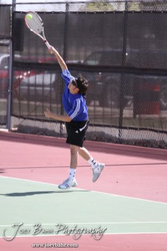 An Ellinwood player serves the ball during the Great Bend Invitiational Boys Tennis Tournament at Great Bend High School in Great Bend, Kansas on March 31, 2012. (Photo: Joey Bahr, www.joeybahr.com)