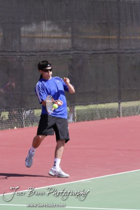 An Ellinwood player returns a volley during the Great Bend Invitiational Boys Tennis Tournament at Great Bend High School in Great Bend, Kansas on March 31, 2012. (Photo: Joey Bahr, www.joeybahr.com)