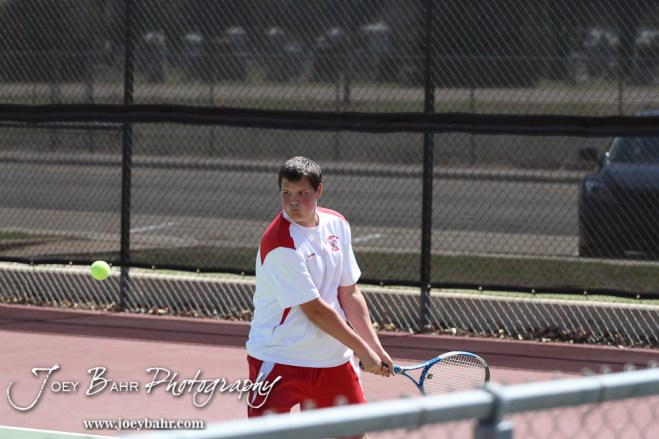 A Hoisington player returns a volley during the Great Bend Invitiational Boys Tennis Tournament at Great Bend High School in Great Bend, Kansas on March 31, 2012. (Photo: Joey Bahr, www.joeybahr.com)