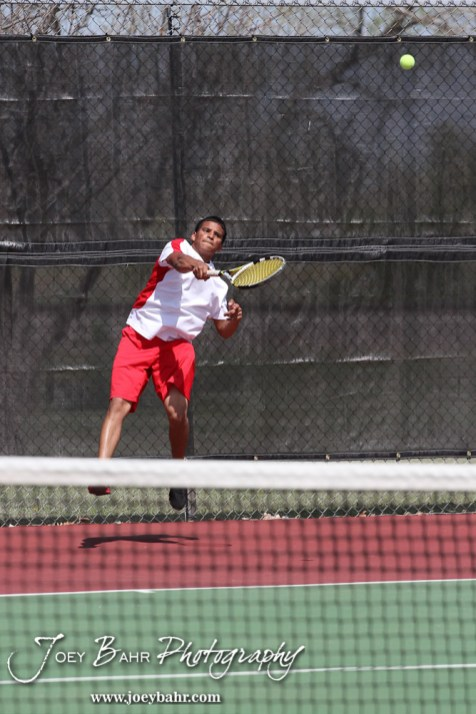 A Hoisington player serves the ball during the Great Bend Invitiational Boys Tennis Tournament at Great Bend High School in Great Bend, Kansas on March 31, 2012. (Photo: Joey Bahr, www.joeybahr.com)