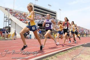 Maddie Hopfinger of St. Thomas Aquinas leads a pack of runners in the Class 5A Girls 1600 Meter Run during the 2012 KSHSAA State Track and Field Championship at Cessna Stadium on the campus of Wichita State University in Wichita, Kansas on May 26, 2012. (Photo: Joey Bahr, www.joeybahr.com)