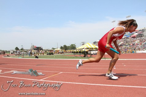 Kyla Vargas of Shawnee Heights takes off in the Class 5A Girls 4 x 100 Meter Relay during the 2012 KSHSAA State Track and Field Championship at Cessna Stadium on the campus of Wichita State University in Wichita, Kansas on May 26, 2012. (Photo: Joey Bahr, www.joeybahr.com)