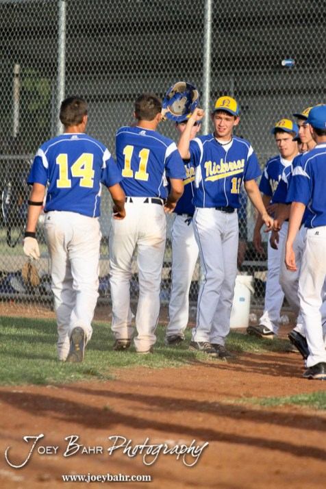 Nickerson Panthers teammates congratulate Quintin Crandall (#11) for scoring against the Colby Eagles at the KSHSAA 4A Regional Baseball Championship at Legion Field in Hoisington, Kansas on May 16, 2012. (Photo: Joey Bahr, www.joeybahr.com)