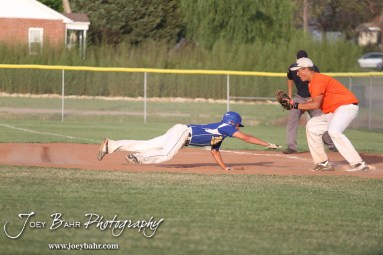 Nickerson Panther Jake Stiverson (#4) dives towards First Base to beat a throw caught by Colby Eagle Braden Sager (#9) at the KSHSAA 4A Regional Baseball Championship at Legion Field in Hoisington, Kansas on May 16, 2012. (Photo: Joey Bahr, www.joeybahr.com)