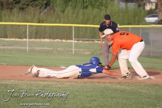 Colby Eagle Braden Sager (#9) tags out Nickerson Panther Jake Stiverson (#4) at the KSHSAA 4A Regional Baseball Championship at Legion Field in Hoisington, Kansas on May 16, 2012. (Photo: Joey Bahr, www.joeybahr.com)