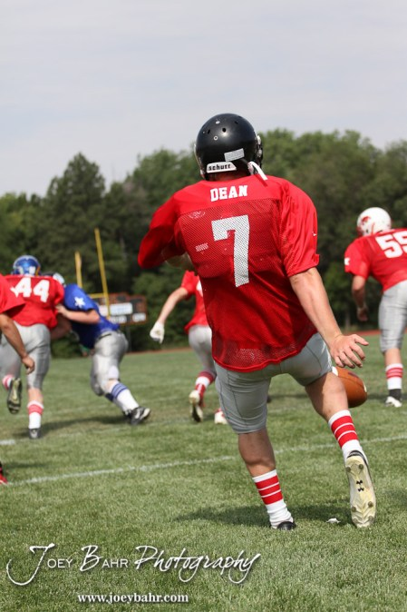 West All-Star Punter Derek Dean of Little River High School (#7) punts during the Kansas Eight Man Football Association Division I All-Star Game at Trojan Field in Beloit, Kansas on June 9, 2012. (Photo: Joey Bahr, www.joeybahr.com)