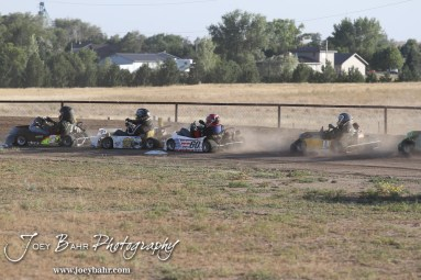 Racers go through Turn 2 in Heat 2 of the Adult/Animal Class at the Ness County Speedway Kart Races sponsored by Walker Tank Service at Ness County Speedway in Ness City, Kansas on August 18, 2012. (Photo: Joey Bahr, www.joeybahr.com)