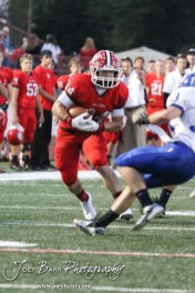McPherson Bullpup Austin Obannon (#24) carries the football during the Winfield at McPherson football game that ended in a 47 to 8 victory for the Bullpups at the McPherson Stadium in McPherson, Kansas on September 28, 2012. (Photo: Joey Bahr, www.joeybahr.com)