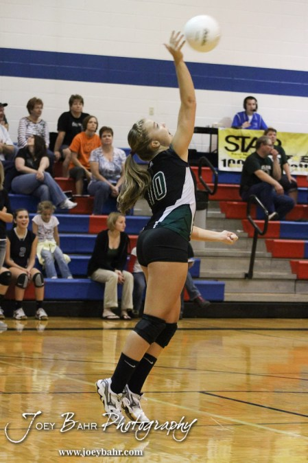 Central Plains Lady Oiler Breanna Holmes (#10) serves during the Central Plains Lady Oilers at Ellinwood Lady Eagles volleyball match at Ellinwood High School in Ellinwood, Kansas on October 11, 2012. (Photo: Joey Bahr, www.joeybahr.com)
