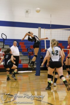 Central Plains Lady Oiler Taylor Rolfs (#14) goes for a kill during the Central Plains Lady Oilers at Ellinwood Lady Eagles volleyball match at Ellinwood High School in Ellinwood, Kansas on October 11, 2012. (Photo: Joey Bahr, www.joeybahr.com)