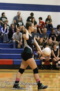 Central Plains Lady Oiler Jennifer Hitschmann (#35) serves during the Central Plains Lady Oilers at Ellinwood Lady Eagles volleyball match at Ellinwood High School in Ellinwood, Kansas on October 11, 2012. (Photo: Joey Bahr, www.joeybahr.com)