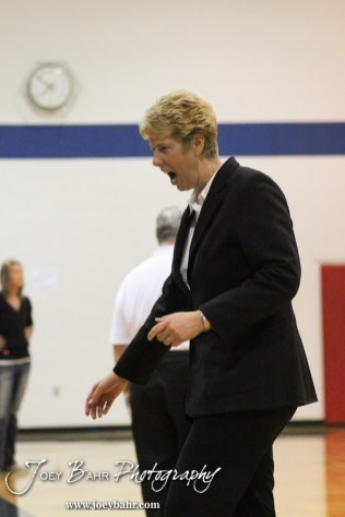 Ellinwood Lady Eagle Head Coach Laurie Feist celebrates winning a game during the Central Plains Lady Oilers at Ellinwood Lady Eagles volleyball match at Ellinwood High School in Ellinwood, Kansas on October 11, 2012. (Photo: Joey Bahr, www.joeybahr.com)
