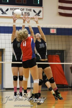 Central Plains Lady Oilers Reagan Phelan (#5) Jennifer Hitschmann (#35) set a wall for a shot from Ellinwood Lady Eagle Lindsey Zink (#4) during the Central Plains Lady Oilers at Ellinwood Lady Eagles volleyball match at Ellinwood High School in Ellinwood, Kansas on October 11, 2012. (Photo: Joey Bahr, www.joeybahr.com)