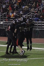 A group of Great Bend Panthers celebrate Jonathan Allende's touchdown during the Great Bend versus Salina South football game with Salina South winning 56-21 at Memorial Stadium at Great Bend High School in Great Bend, Kansas on October 26, 2012. (Photo: Joey Bahr, www.joeybahr.com)