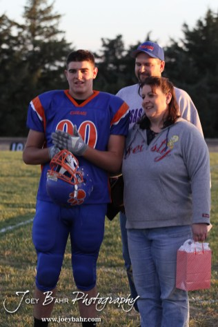 Otis-Bison Cougar Tyler Maier (#90) stands with his parents before the Wilson High School at Otis-Bison High School Eight Man Division II District 7 matchup with Otis-Bison winning 60-14 in Otis, Kansas on October 19, 2012. (Photo: Joey Bahr, www.joeybahr.com)