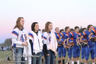 Members of the Otis-Bison Cougar training staff stand for the National Anthem before the Wilson High School at Otis-Bison High School Eight Man Division II District 7 matchup with Otis-Bison winning 60-14 in Otis, Kansas on October 19, 2012. (Photo: Joey Bahr, www.joeybahr.com)