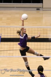 Wilson Lady Dragon Kasey Davis (#1) hits a ball over the net during the Wilson versus Weskan KSHSAA Class 1A Division II State Volleyball Pool II match with Weskan winning 26-24, 25-12 in Hays, Kansas on October 26, 2012. (Photo: Joey Bahr, www.joeybahr.com)