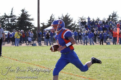 Otis-Bison Cougar Kole Urban (#1) scores a touchdown during the Thunder Ridge at Otis-Bison KSHSAA Eight Man Division II Regional Game with Thunder Ridge winning 28-18 at Otis-Bison High School in Otis, Kansas on November 3, 2012. (Photo: Joey Bahr, www.joeybahr.com)