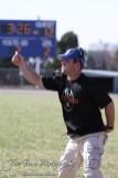 Otis-Bison Cougar Head Coach Travis Starr signals in a play during the Thunder Ridge at Otis-Bison KSHSAA Eight Man Division II Regional Game with Thunder Ridge winning 28-18 at Otis-Bison High School in Otis, Kansas on November 3, 2012. (Photo: Joey Bahr, www.joeybahr.com)