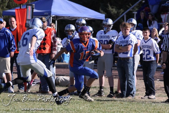 Otis-Bison Cougar Justus Bartonek (#15) runs with a pass he caught during the Thunder Ridge at Otis-Bison KSHSAA Eight Man Division II Regional Game with Thunder Ridge winning 28-18 at Otis-Bison High School in Otis, Kansas on November 3, 2012. (Photo: Joey Bahr, www.joeybahr.com)