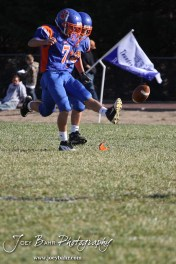 Otis-Bison Cougar Nick Higgason (#7) kicks the ball off during the Thunder Ridge at Otis-Bison KSHSAA Eight Man Division II Regional Game with Thunder Ridge winning 28-18 at Otis-Bison High School in Otis, Kansas on November 3, 2012. (Photo: Joey Bahr, www.joeybahr.com)