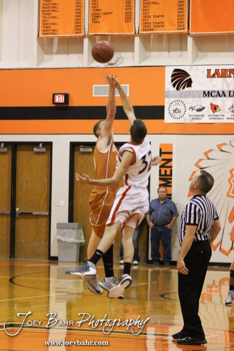 Kiowa County Maverick Rustin Ardery (#21) and Larned Indian Nolan Allison (#32) jump for the tip-off during the Larned Indians versus Kiowa County Mavericks First Round Game with Kiowa County winning 63 to 45 at the 6th Annual Keady Basketball Classic held at Larned Middle School in Larned, Kansas on December 3, 2012. (Photo: Joey Bahr, www.joeybahr.com)