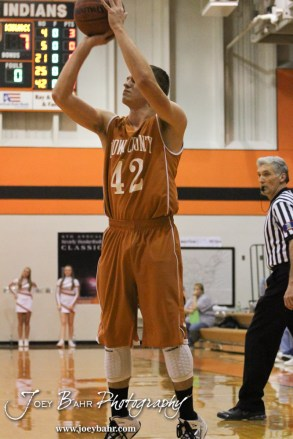 Kiowa County Maverick Kendall Watson (#42) takes a jump shot during the Larned Indians versus Kiowa County Mavericks First Round Game with Kiowa County winning 63 to 45 at the 6th Annual Keady Basketball Classic held at Larned Middle School in Larned, Kansas on December 3, 2012. (Photo: Joey Bahr, www.joeybahr.com)