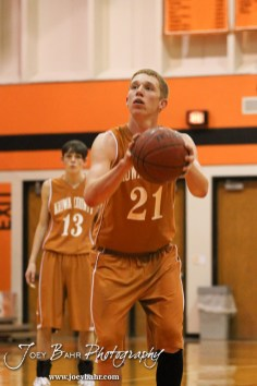 Kiowa County Maverick Rustin Ardery (#21) shoots a free throw attempt during the Larned Indians versus Kiowa County Mavericks First Round Game with Kiowa County winning 63 to 45 at the 6th Annual Keady Basketball Classic held at Larned Middle School in Larned, Kansas on December 3, 2012. (Photo: Joey Bahr, www.joeybahr.com)