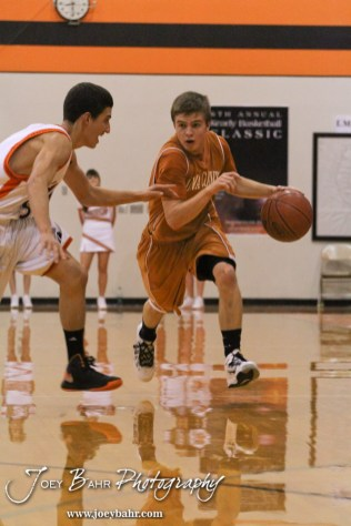 Kiowa County Maverick Caleb Davis (#4) drives the ball down the court during the Larned Indians versus Kiowa County Mavericks First Round Game with Kiowa County winning 63 to 45 at the 6th Annual Keady Basketball Classic held at Larned Middle School in Larned, Kansas on December 3, 2012. (Photo: Joey Bahr, www.joeybahr.com)