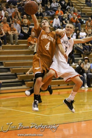 Larned Indian Brayden Smith (#3) tries to block a layup by Kiowa County Maverick Caleb Davis (#4) during the Larned Indians versus Kiowa County Mavericks First Round Game with Kiowa County winning 63 to 45 at the 6th Annual Keady Basketball Classic held at Larned Middle School in Larned, Kansas on December 3, 2012. (Photo: Joey Bahr, www.joeybahr.com)