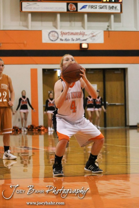 Larned Lady Indian Roxy Foster (#4) shoots a free throw attempt during the Larned Lady Indians versus Kiowa County Lady Mavericks First Round Game with Larned winning 50 to 39 at the 6th Annual Keady Basketball Classic held at Larned Middle School in Larned, Kansas on December 3, 2012. (Photo: Joey Bahr, www.joeybahr.com)