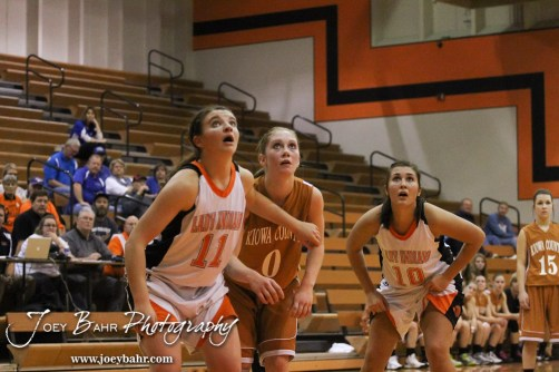Larned Lady Indian Reagan Quick (#11), Kiowa County Lady Maverick Katelynn Gamble (#0), and Larned Lady Indian Bailey Schartz (#10) watch the ball during a free throw attempt during the Larned Lady Indians versus Kiowa County Lady Mavericks First Round Game with Larned winning 50 to 39 at the 6th Annual Keady Basketball Classic held at Larned Middle School in Larned, Kansas on December 3, 2012. (Photo: Joey Bahr, www.joeybahr.com)