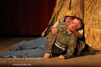 """Duane played by K.B. Bell and Duwell played by Charlie Dixon wrestle during the Great Bend Community Theater's final rehearsal of """"Duck Hunter Shoots Angel"""" by Mitch Albom at Crest Theater in Great Bend, Kansas on April 17, 2013. (Photo: Joey Bahr, www.joeybahr.com)"""